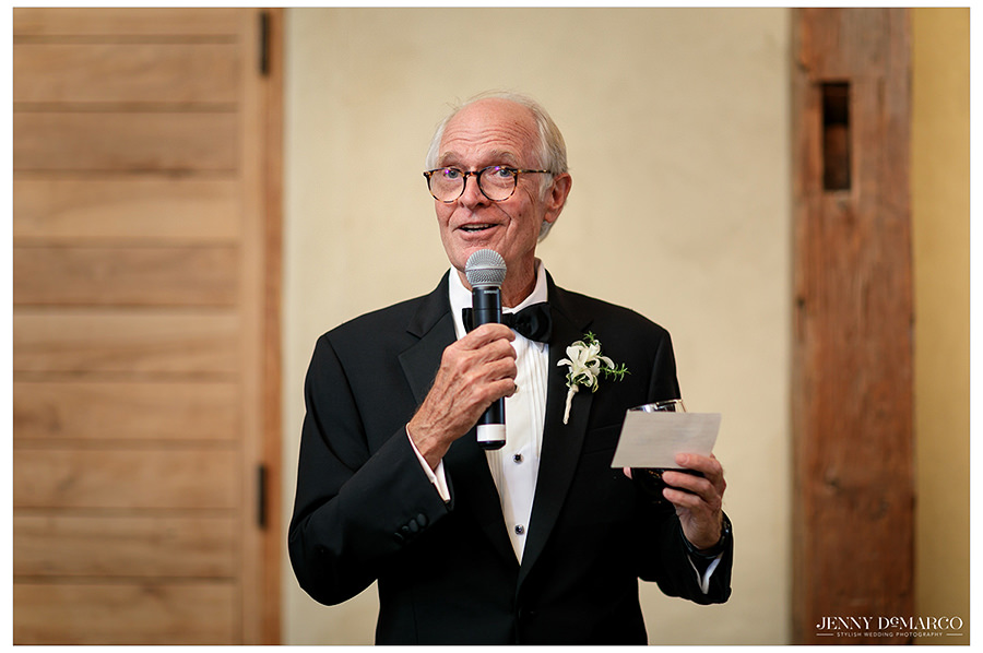 the father of the bride prepares a sweet toast for the couple