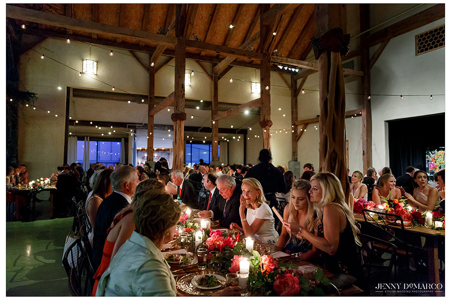 the guests share dinner in conversation in the beautiful barr mansion