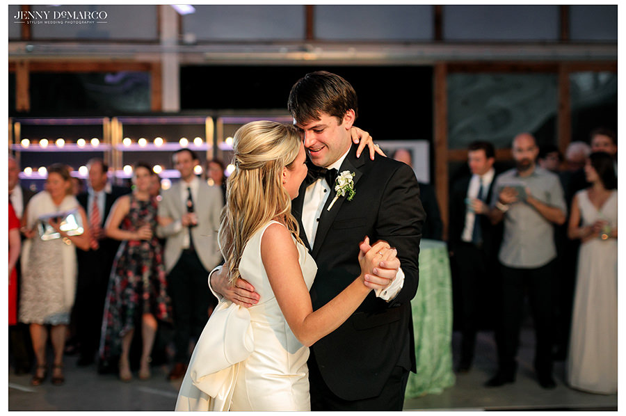 the bride and groom share a classic and lovely first dance