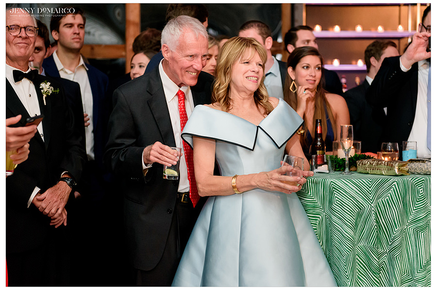 the parents watch their children dance at the elegant reception