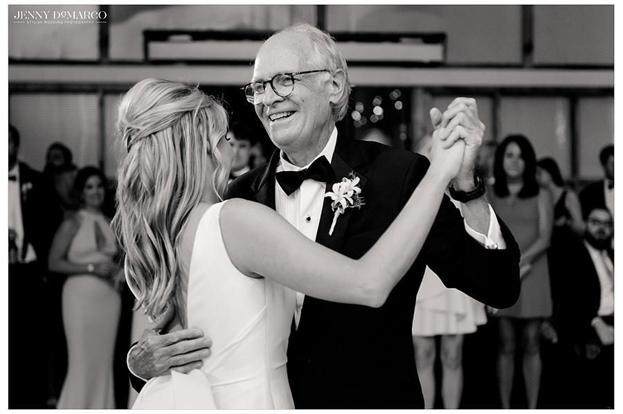 the bride dances with her father in the ballroom of the barr mansion