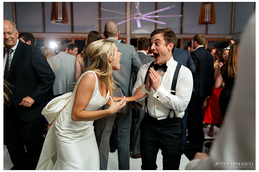 the bride and best man share a lovely moment in fun wedding shot