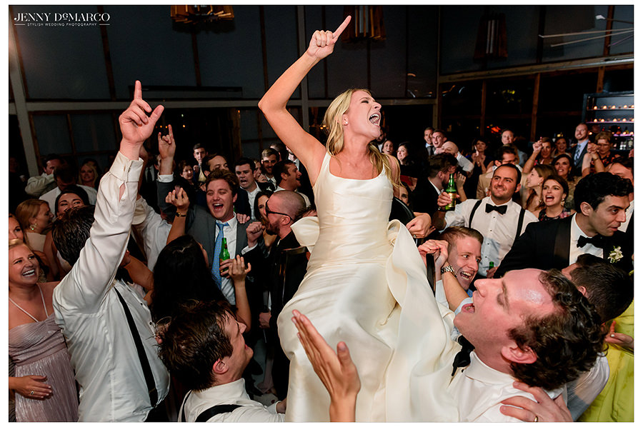the bride is lifted up and danced around at barr mansion wedding