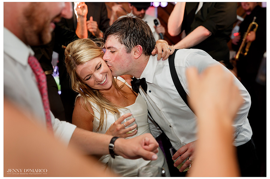 the groom kisses the bride at the timeless barr mansion wedding