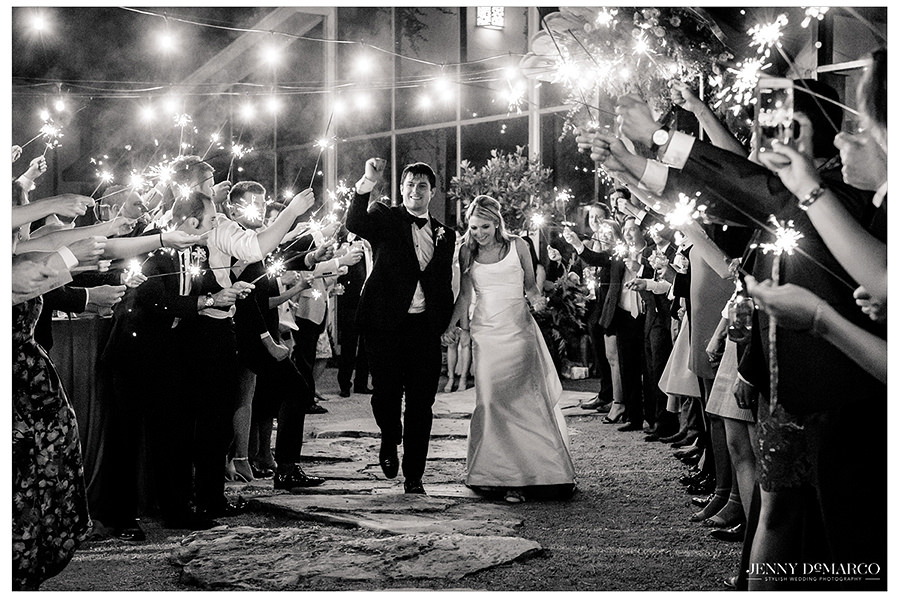 the beautiful couple leave their timeless wedding at the barr mansion property