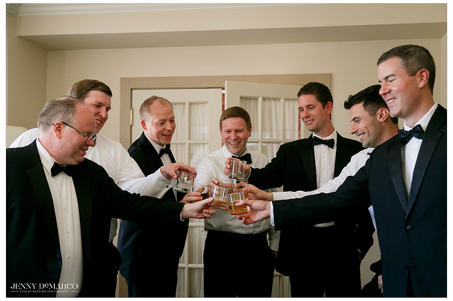 a celebratory toast between the groom and groomsmen