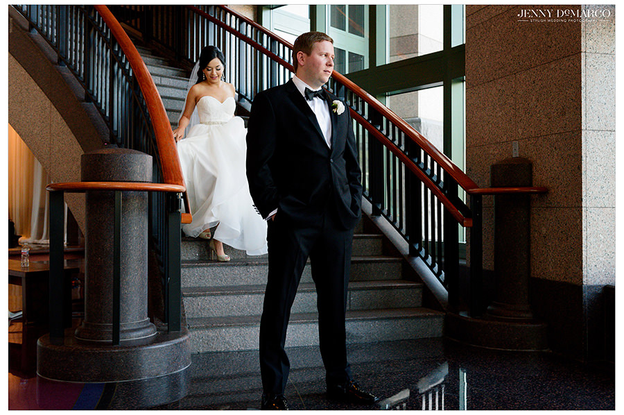 the bride and groom at a beautiful first look at The Bob Bullock Museum