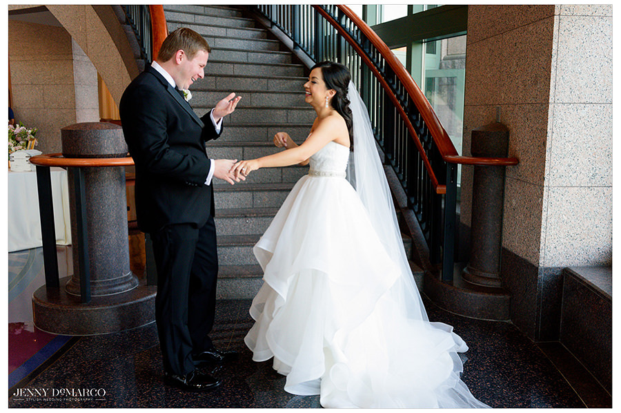 the groom smiles as he sees his bride for the first time at the Bob Bullock Museum