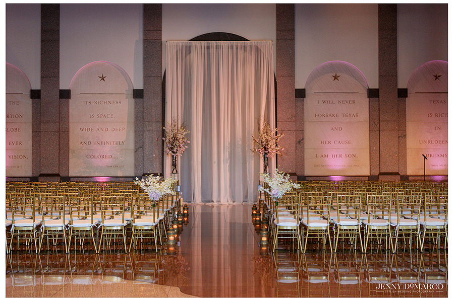 an elegant shot of the gold and pink details of the Bob Bullock Museum wedding