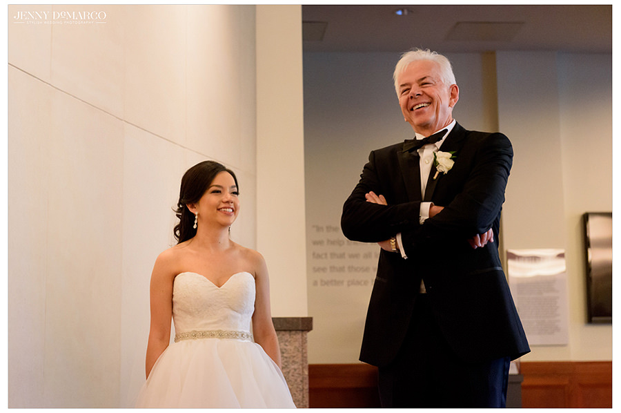 the bride and her father share a special moment before going down the isle
