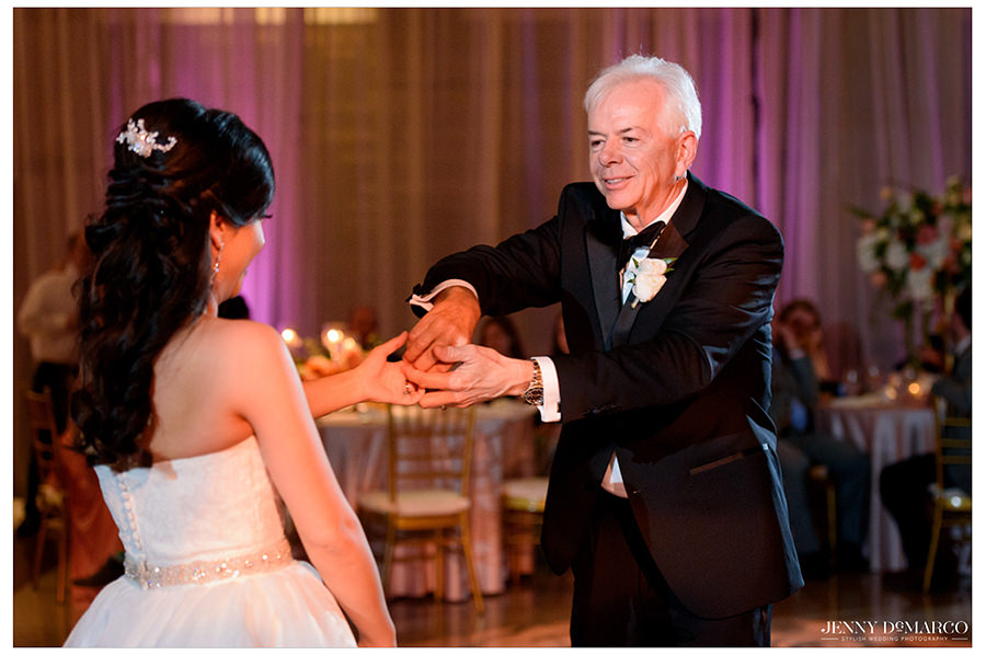 the father of the bride and bride share a father daughter dance