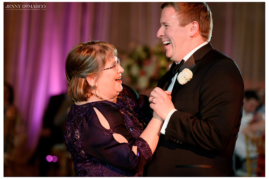 mother and son dance under the lights at the museum