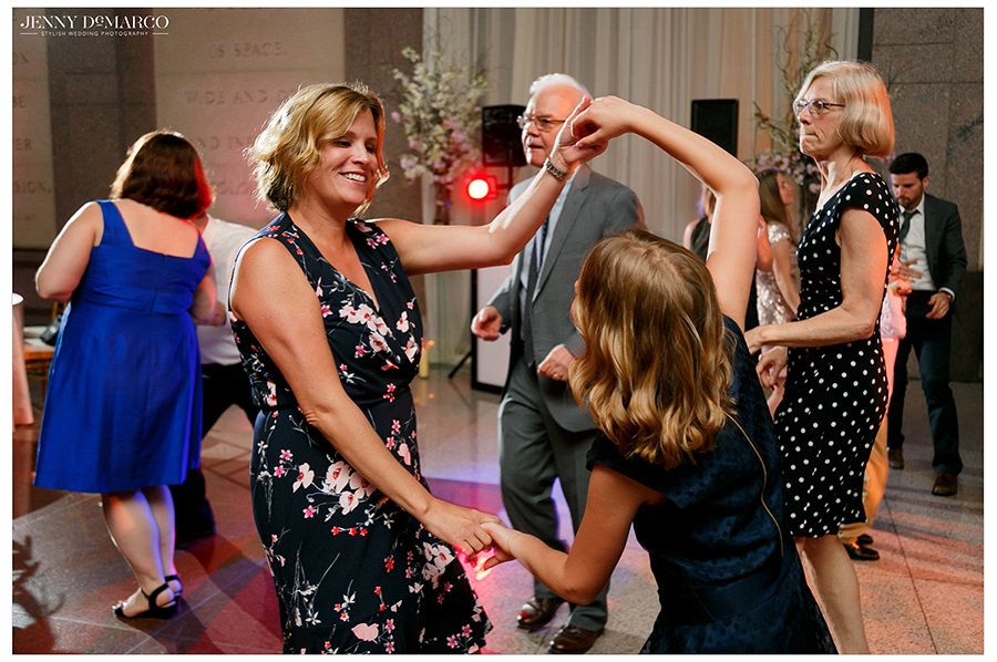 the guests dance around at the wedding