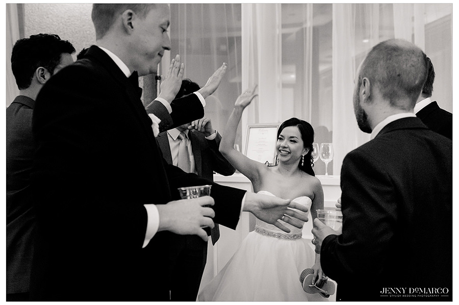 high fives given to the happy couple