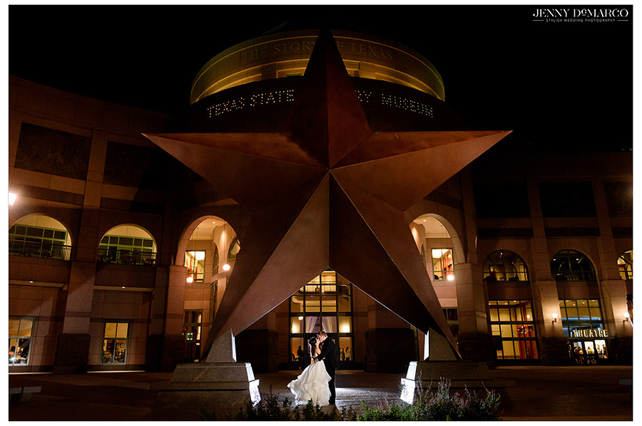 the couple stands in front of the Texas state history museum