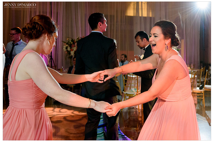 the party continues to dance at the reception