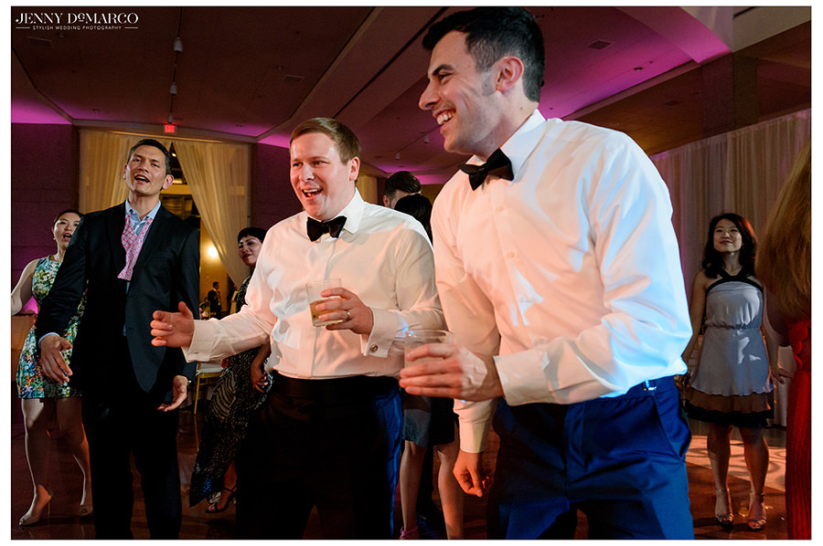 the groom and best man share one last danceoff