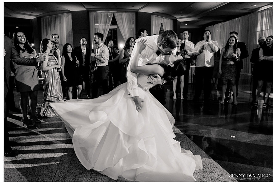 the couple share one last kiss at the Texas State history museum wedding