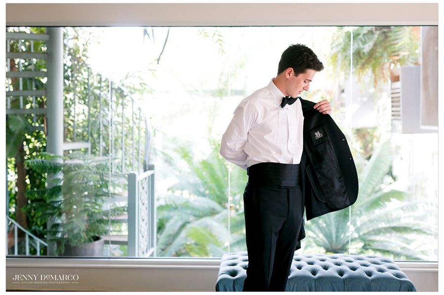 groom prepares to see his bride at elegant first look