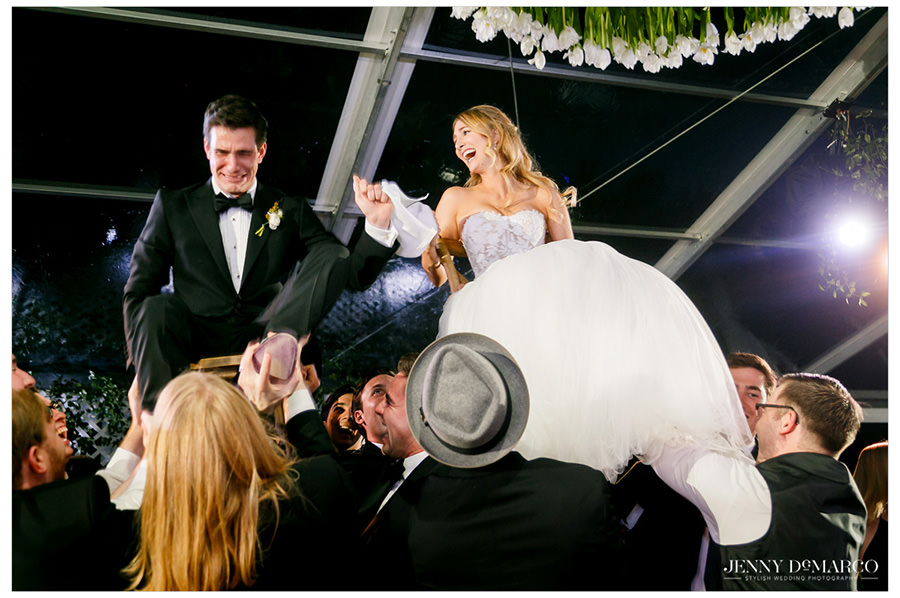 Bride and groom dance the Hora in the heart of the hill country