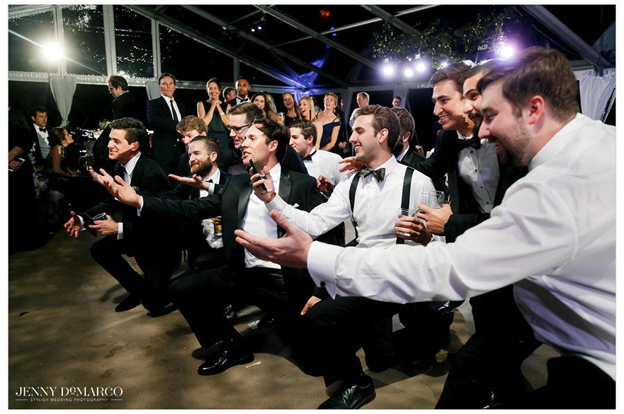 groomsmen dance during the reception of the elegant hill country