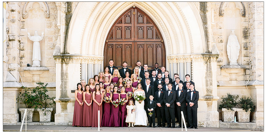 full wedding party shown in brown leather signature album spread