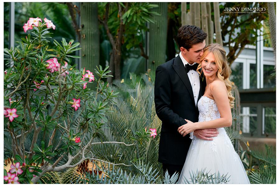 Bride & Groom share a moment in the greenhouse