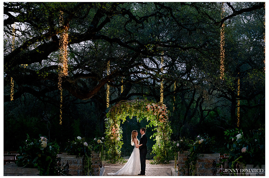 the couple share one last moment at the beautiful alter under the sacred oaks