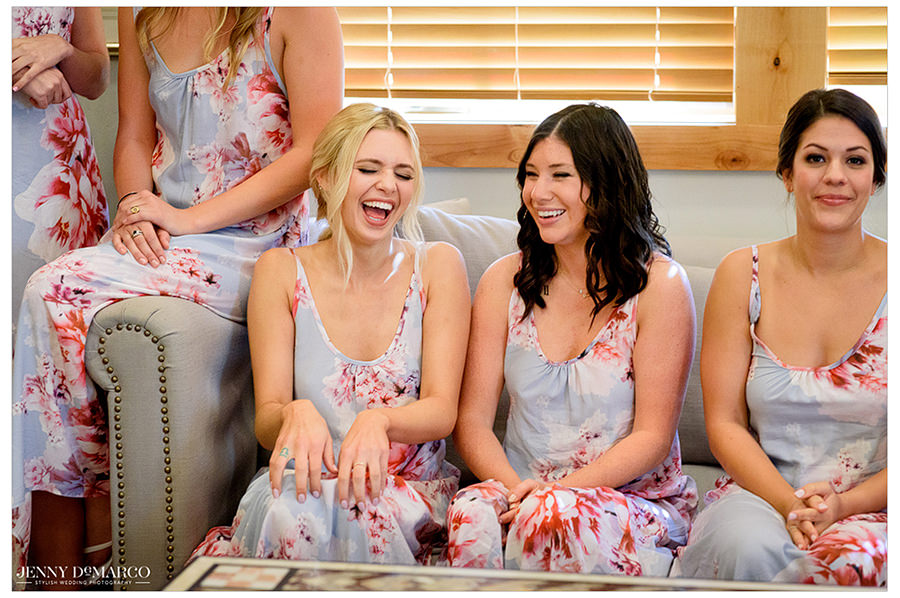 the bridesmaids laughing in their matching robes
