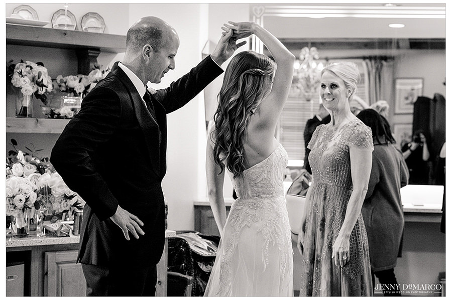 the father of the bride twirls his daughter around