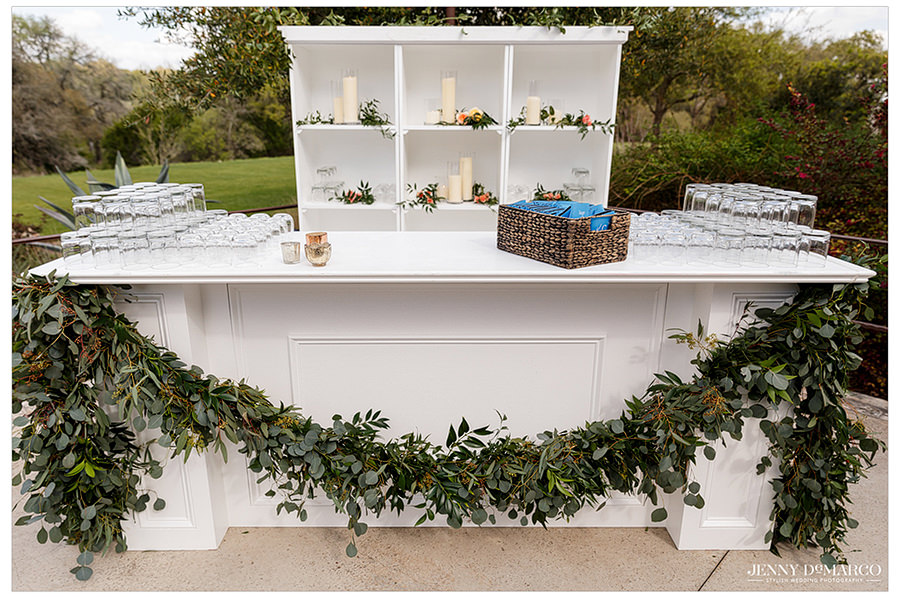 the white bar surrounded by greenery