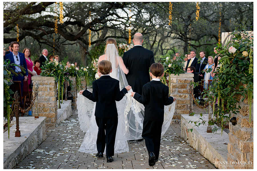 the father of the bride walks her down the Sacred Oaks aisle