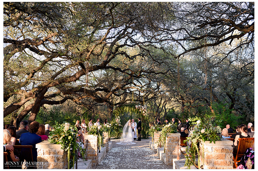 the couple have their kiss under the sacred oaks at camp lucy