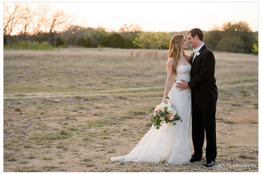 the couple shares a touching moment in the field before their reception