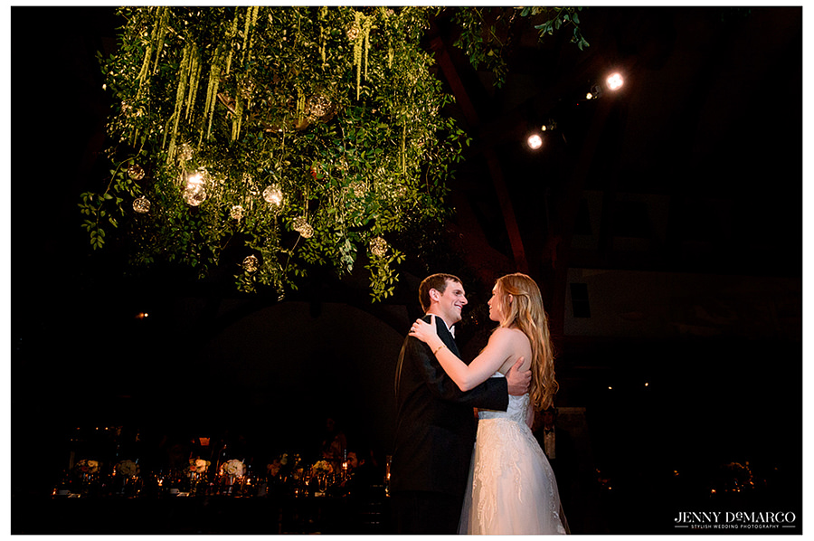 the couple shares their last dance under the hanging vines