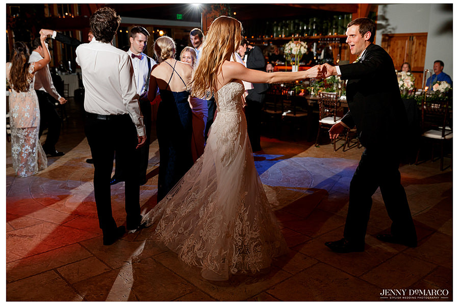 the brides lace dress shining off the floor in a dance with her new husband