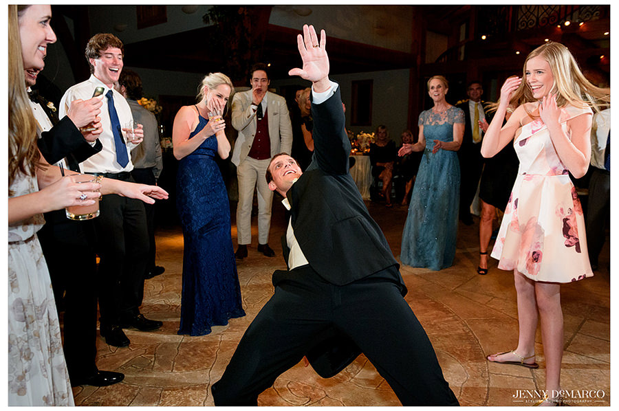 the groom breaking it down on the dance floor