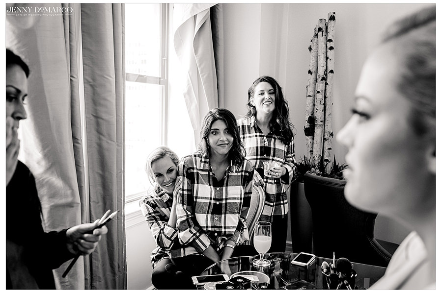 a black and white shot of the bridesmaids getting ready for the big day