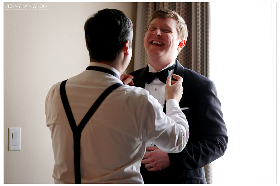 the groom giggling before the fist look