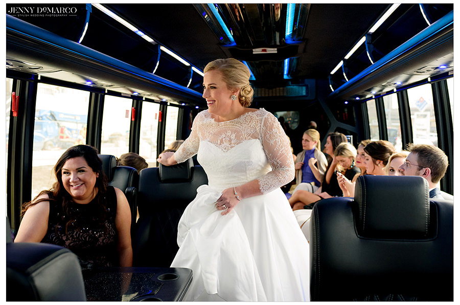 the bride to be in their fun party bus before the reception