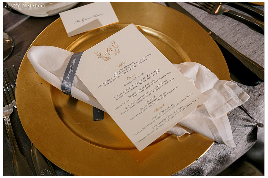 a close up shot of the gold and white details of the table arrangements