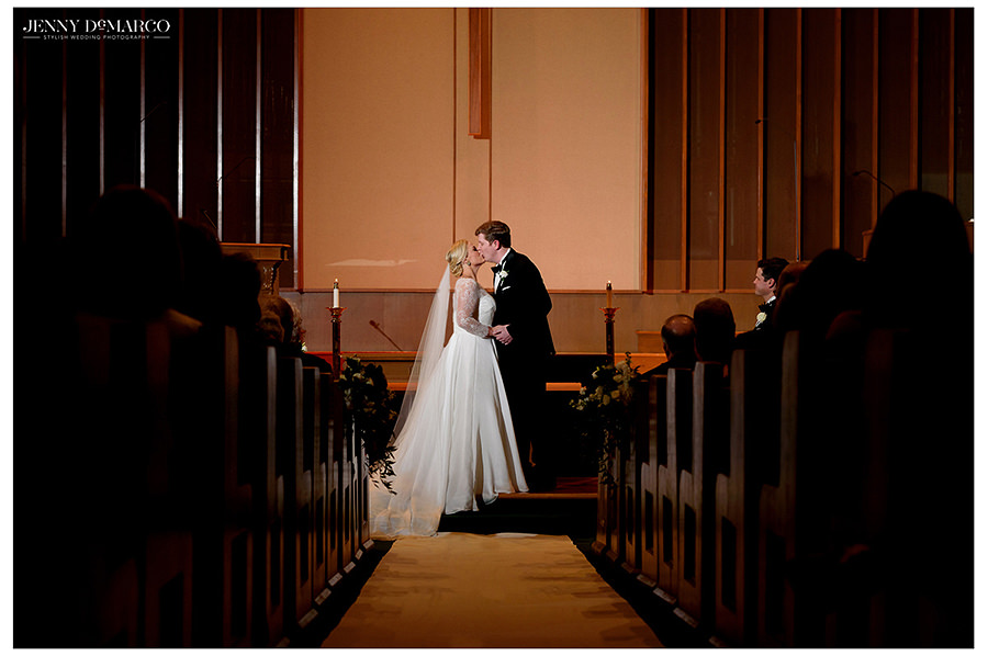 the bride and grooms first kiss at a beautiful ceremony