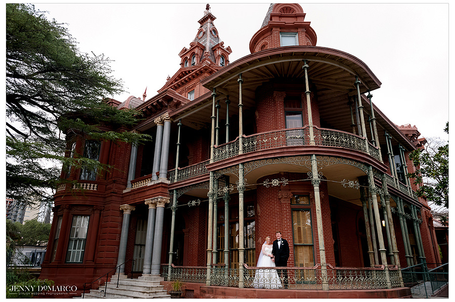 the bride and groom in a beautiful shot in front of the littlefield home