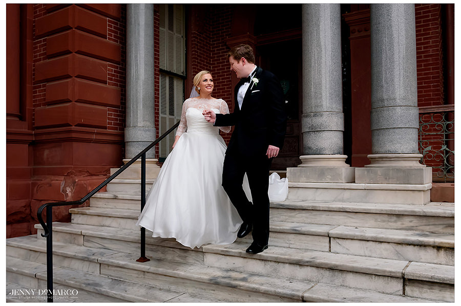 the bride and groom as they exit the ceremony surrounded by antique red sandstone brick