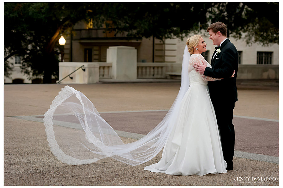 a beautiful wide shot of the white lace on the brides dress