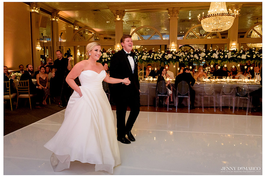 the bride and groom as they enter their wedding reception at the Austin Club