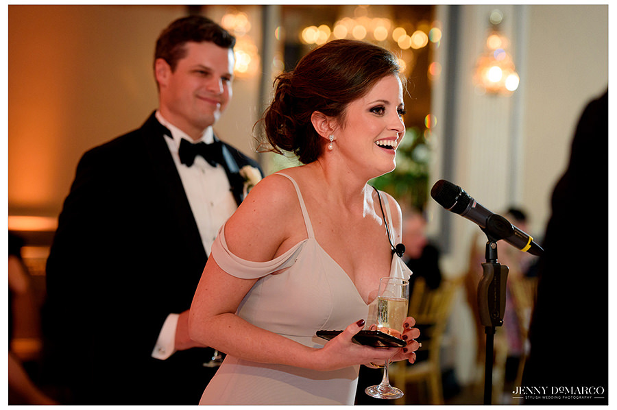 a shot of the maid of honor giving a toast