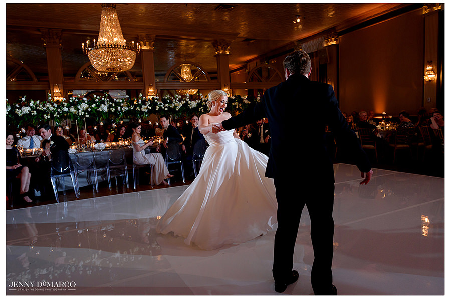 the bride twirls at the Austin Club Wedding