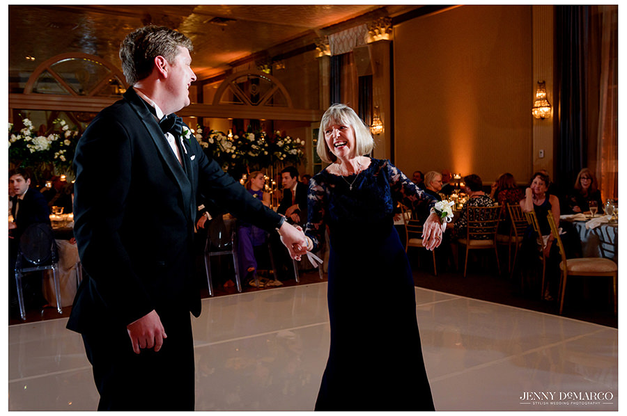 the groom dances with his mom at the Club Wedding