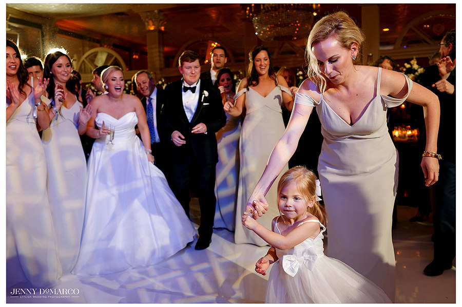 the bride dancing with her flower girl
